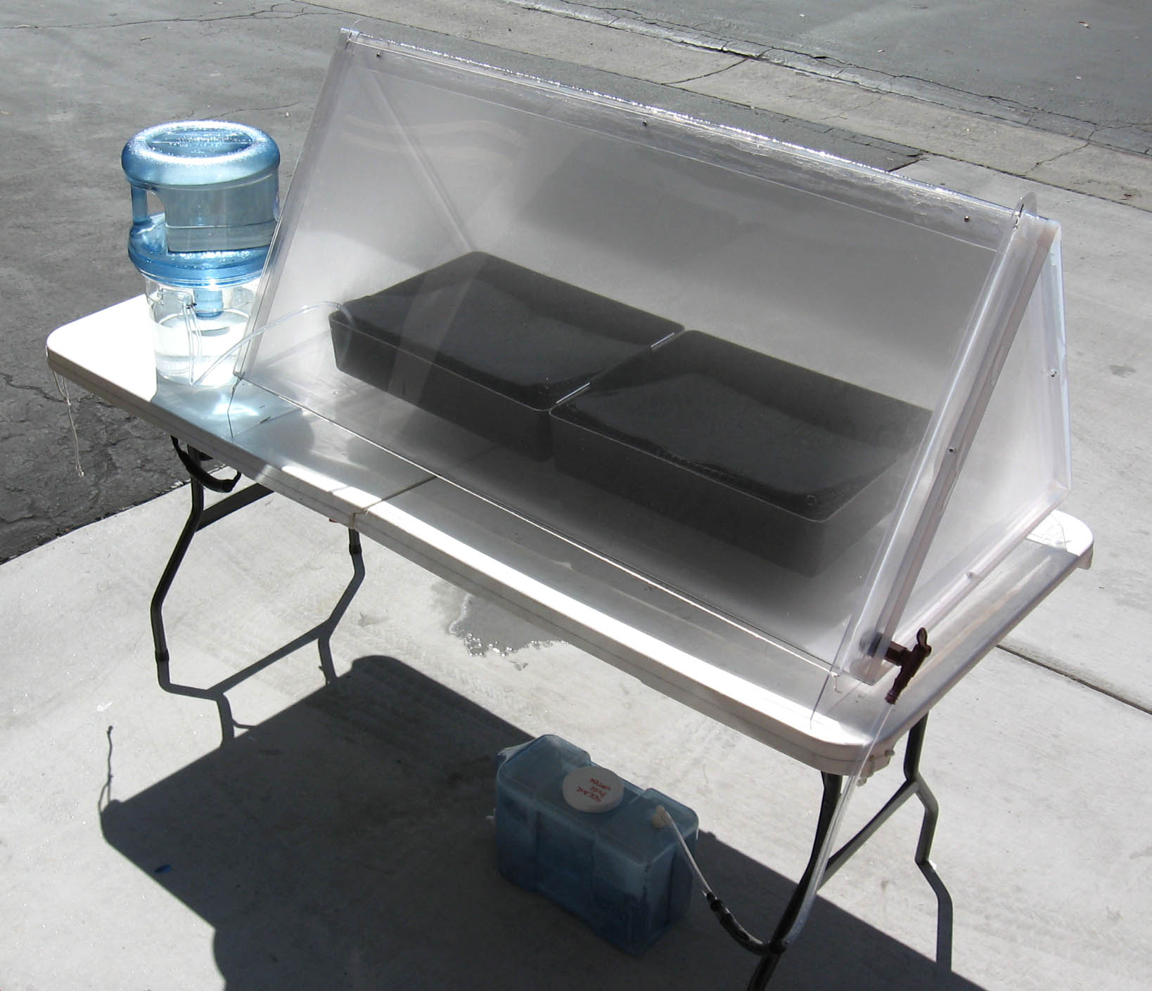Our discontinued first generation triangular shaped Solar Still Water Purifier