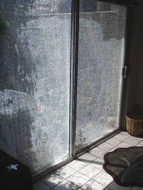 SolarFlex thermal barrier fabric on patio door exterior